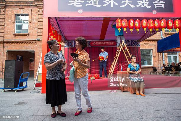 To celebrate the Mid Autumn festival local residents set a stage in the inner yard Actresses are rehearsing Pingju which is a popular opera in Harbin...
