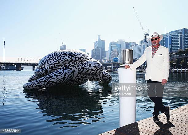 To celebrate the world's first Undersea Art Exhibition a 5 metre tall 15 metre long Sea Turtle arrives at Cockle Bay and poses behind the artist BJ...