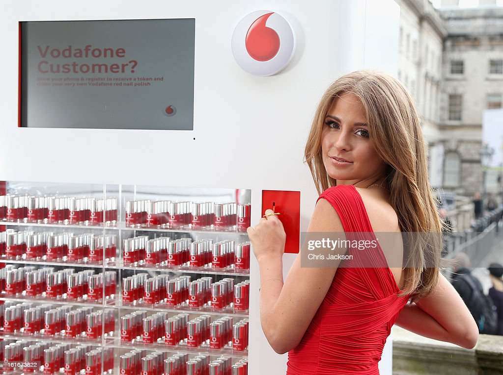 To celebrate Vodafone's sponsorship of London Fashion Week and London Fashion Weekend, Millie Mackintosh samples the new Vodafone Red nail polish, developed in partnership with Nails inc. at Somerset House on February 14, 2013 in London, England.