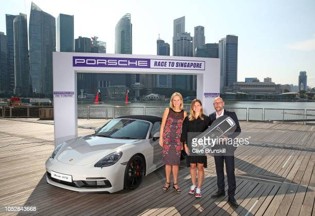 To celebrate winning the WTAÕs 2018 Porsche Race to Singapore Simona Halep of Romania is presented with a brand new Porsche 718 Boxster GTS while...