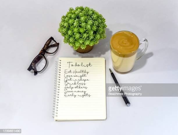 to do list on notebook page on a white table - dalgona stock pictures, royalty-free photos & images