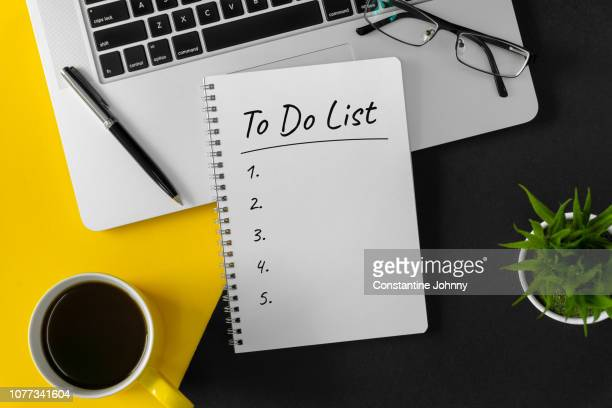 to do list on notebook page with laptop and coffee mug - to do list stock pictures, royalty-free photos & images