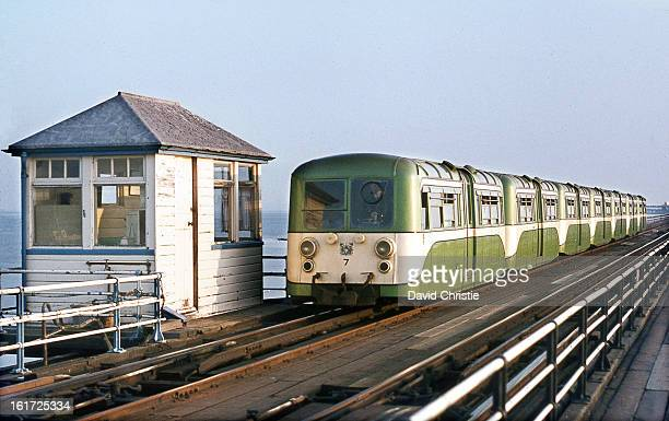CONTENT] To end this Electric section with a rather unique service the Southend Pier Railway Here is a train made up of 1949 built cars on 8/10/72...