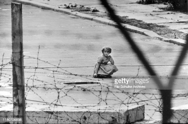 To give the impression of normality East German authorities sent children to the base of the Berlin Wall to act as if they were at play Berlin 1962