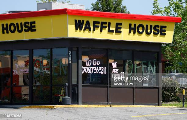 To Go orders are accepted at a Waffle House on Washington Road as the coronavirus pandemic causes closure of eatin restaurants on March 30 2020 in...