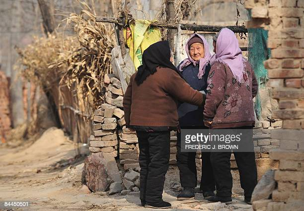 To go w/Finance-economy-unemployment-Lunar by Fran Wang Elderly women farmers chat outside their homes in the rural town of Lankao on January 18 in...