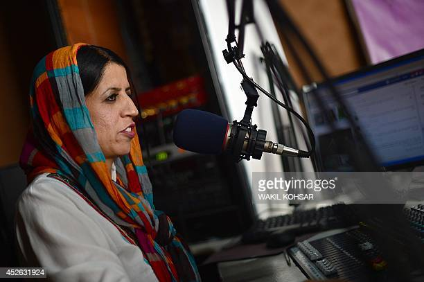 To go with AfghanistanunrestmediapoliticsFEATURE by Anuj CHOPRA In this photograph taken on June 10 Afghan radio deejay Seema Safa talks on air...