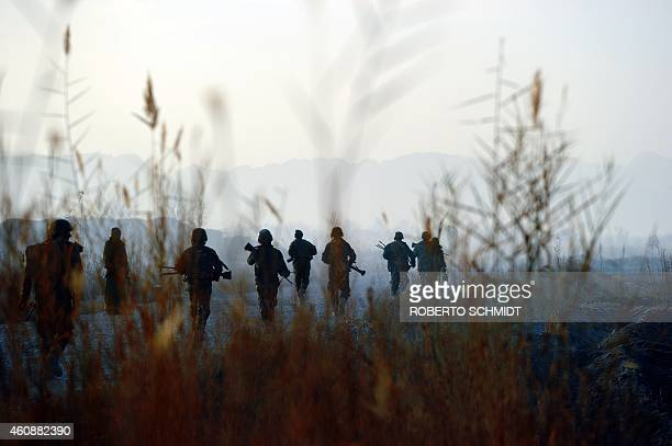 To go with 'Afghanistan-Unrest-Military' FOCUS by Ben Sheppard In this photograph taken on December 11 Afghan soldiers from the 2nd unit of the third...