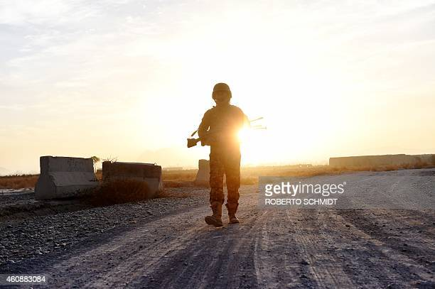 To go with 'AfghanistanUnrestMilitary' FOCUS by Ben Sheppard In this photograph taken on December 11 2014 an Afghan soldier from the 2nd unit of the...