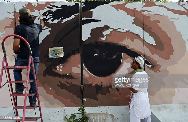 To go with AfghanistanunrestpoliticscorruptionartsFOCUS by Guillaume Decamme In this photograph taken on July 21 Afghan artists and volunteers paint...