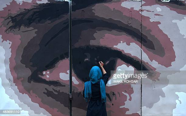 To go with AfghanistanunrestpoliticscorruptionartsFOCUS by Guillaume Decamme In this photograph taken on July 21 an Afghan artist paints the design...