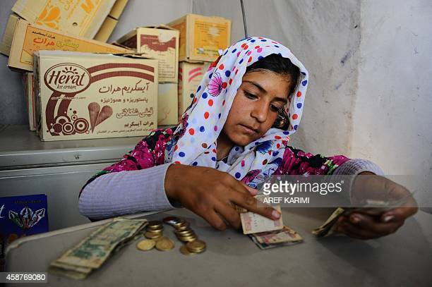 To go with Afghanistanunrestpovertychildren In this September 28 2014 image Afghan child Fatima counts the money she earned from selling icecream...