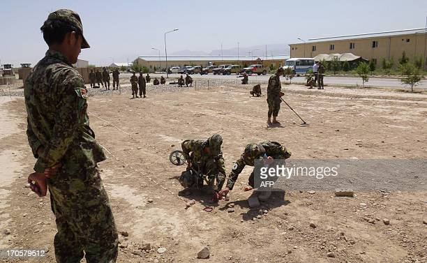 To go with AfghanistanunrestsecurityFOCUS by Benjamin SHEPPARD In this picture taken on June 12 Afghanistan National Army recruits take part in a...