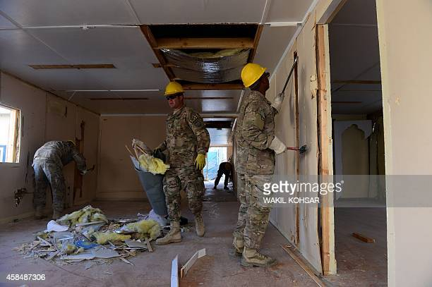 To go with Afghanistan-unrest-US-Bagram,FEATURE by Emmanuel PARISSE In this photograph taken on November 1 US soldiers remove panels and insulation...