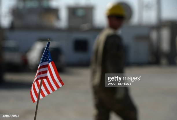 To go with AfghanistanunrestUSBagramFEATURE by Emmanuel PARISSE In this photograph taken on November 1 a US flag is pictured as demolition work...