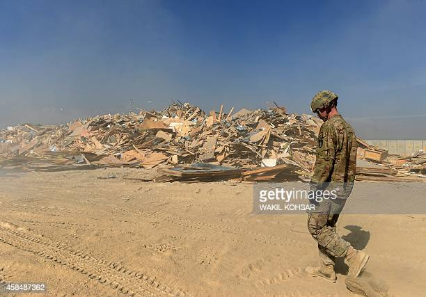 To go with Afghanistan-unrest-US-Bagram,FEATURE by Emmanuel PARISSE In this photograph taken on November 1 a US soldier walks past a pile of...