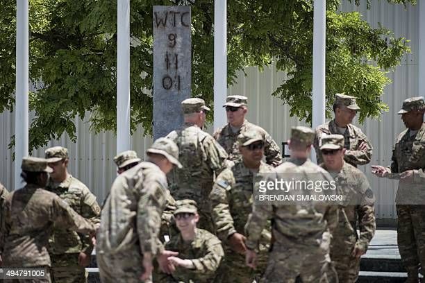 To go with AfghanistanunrestUSmilitaryveteranshealthFOCUS by Daniel De Luce This photo taken on May 28 2014 shows returning veterans being greeted by...