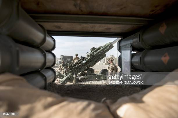 To go with AfghanistanunrestUSmilitaryveteranshealthFOCUS by Daniel De Luce This photo taken on May 28 2014 shows US soldiers preparing artillery for...