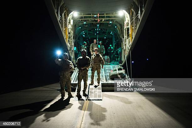 To go with Afghanistan-unrest-US-NATO-military-health,FOCUS by Dan De Luce In this photograph taken on May 26, 2014 members of the US Air Force on an...