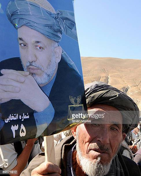 To go with AFGHANISTANVOTEPOLITICSKARZAI FOCUS by Charlotte McDonaldGibson Afghans attend President Hamid Karzai's first campaign rally outside the...