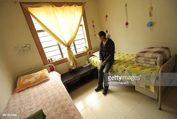 CHINAHEALTHDRUGS Twenty eightyearold recovering drug addict Wan Yannan sits on her bed in her room at the Kunming Municipal Compulsory Rehabilitation...