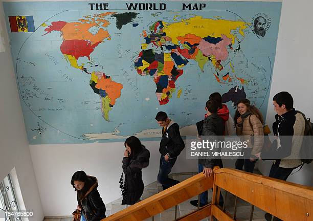 To go with AFP story by Isabelle Wesselingh Students walk downstairs inside the 'BP Hasdeu' highschool to attends a play about human trafficking...
