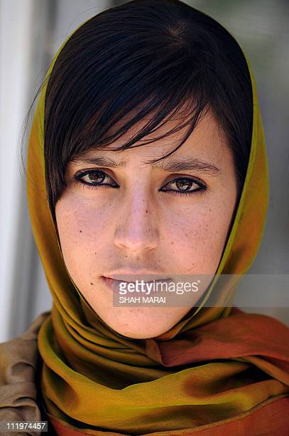 To go with AFP story by Lynne O'Donnell AFGHANISTANVOTEWOMENYoung Afghan woman Farida Kawoon looks on during an interview with a AFP reporter in...