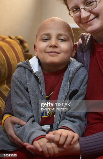 To go with AFP story by Mihaela Rodina Raul Sargu a cancer suffering Romanian boy poses with his mother at Pavel foundation headquarters inside the...