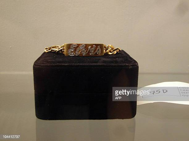 To GO WITH AFP STORY by Natalie Huet USAauctionpeoplecurious Singer Elvis Presley's ID bracelet given to the American rock star in 1963 is on display...