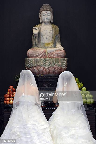 To go with AFP story 'TaiwanAsiamarriagereligionBuddhismsocietygayFOCUS by Peter Harmsen' This picture taken on August 11 2012 shows Taiwanese women...