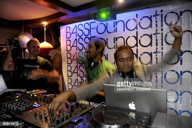 LIFESTYLEINDIAMUSICENTERTAINMENT Indian discjockeys Nasha and Nucleya are watched by a member of the audience as they play music at a nightclub in...