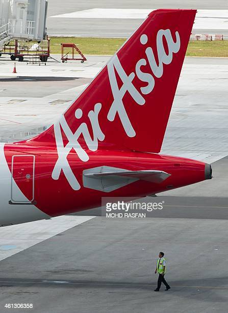 To go with AFP story IndonesiaMalaysiaSingaporeaviationAirAsiacompanyFOCUS by Satish Cheney This photo taken on January 10 2015 shows a ground staff...