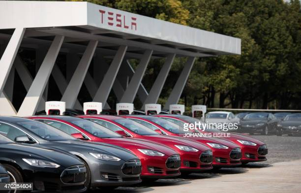 To go with AFP story ChinaautoshowenvironmentTeslaFOCUS by Bill Savadove This picture taken on March 17 2015 shows Tesla Model S vehicles parked...