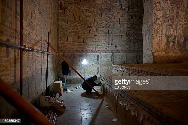 To go with AFP story China-heritage-technology-art,FEATURE by Sebastien Blanc In a photo taken on May 13, 2013 a technician performs restoration work...
