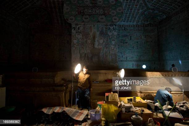 To go with AFP story ChinaheritagetechnologyartFEATURE by Sebastien Blanc In a photo taken on May 13 2013 technicians work to restore one of the...