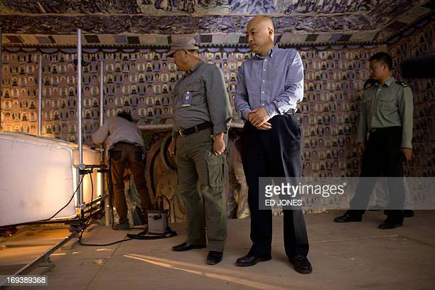 To go with AFP story ChinaheritagetechnologyartFEATURE by Sebastien Blanc In a photo taken on May 13 2013 Wang Xudong director general of the...