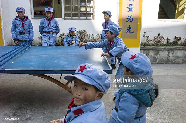 To go with AFP story ChinapoliticseducationhistoryFEATURE by Tom Hancock In this picture taken on January 21 children dressed in uniform play table...