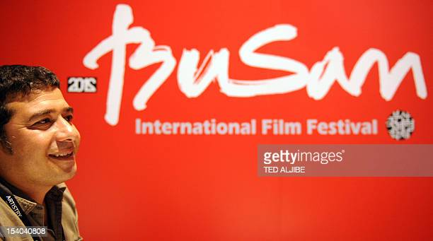 To go with AFP story EntertainmentSKoreaIranwesternsfilmfestival by Mathew Scott In a picture taken on October 7 Iranian documentary director Kamran...
