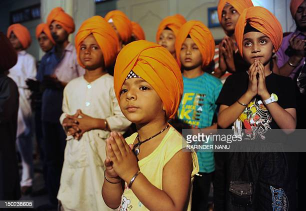 To go with AFP story IndiaculturereligionSikhturbanFEATURE by Ammu Kannampilly This picture taken on July 7 2012 shows young Indian Sikh members...