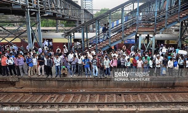 To go with AFP story IndiaeconomyinfrastructurerailFEATURE by Aditya Phatak In this photograph taken on April 7 Indian commuters crowd onto a...