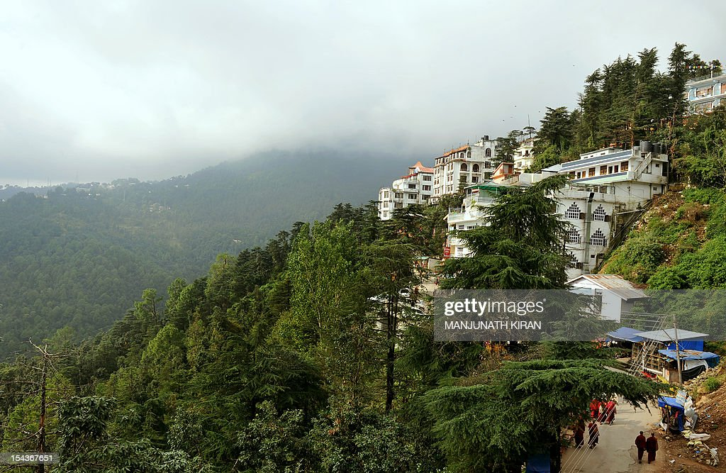To go with AFP story 'India-Tibet-travel-tourism-religion,FEATURE' by Ben Sheppard This picture taken on September 25, 2012 shows a general view of hillside hotels, restaurants and shops on a slope in McLeod Ganj, Dharamshala. Once the refuge of pious Tibetan monks and a few hippie travellers, Dharamshala in the Himalayan foothills is today a crowded and chaotic town where long-term residents fear for its future. AFP PHOTO / Manjunath KIRAN