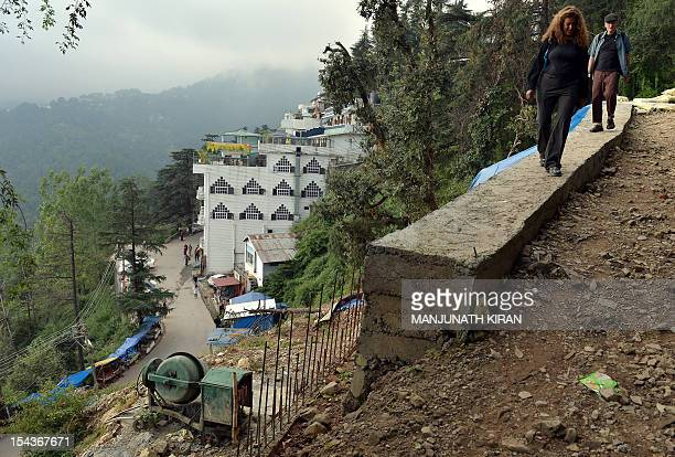 To go with AFP story 'IndiaTibettraveltourismreligionFEATURE' by Ben Sheppard This picture taken on September 28 2012 shows a foreign tourists...