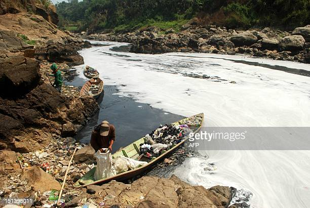 IndonesiaenvironmentpollutionriverFEATURE by Vincent Souriau This picture taken on August 31 2012 shows an Indonesian scavenger collecting recycled...