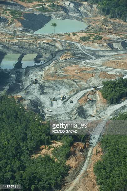 To go with AFP story IndonesiaFranceenvironmentanimalFEATURE by Loic Vennin This aerial photograph taken on June 7 2012 shows a coal mining...
