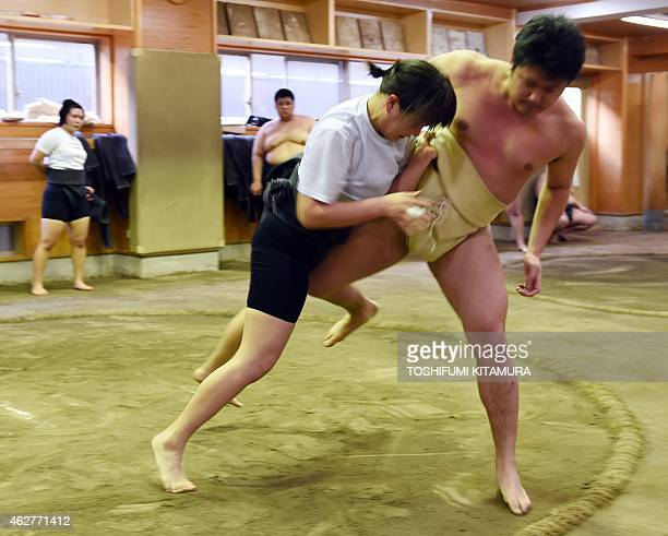 To go with AFP story JapanSocialWomenSumo Feature by Jessica Glanz In a photograph taken on January 25 female sumo wrestler Shiori Kanehira fights...