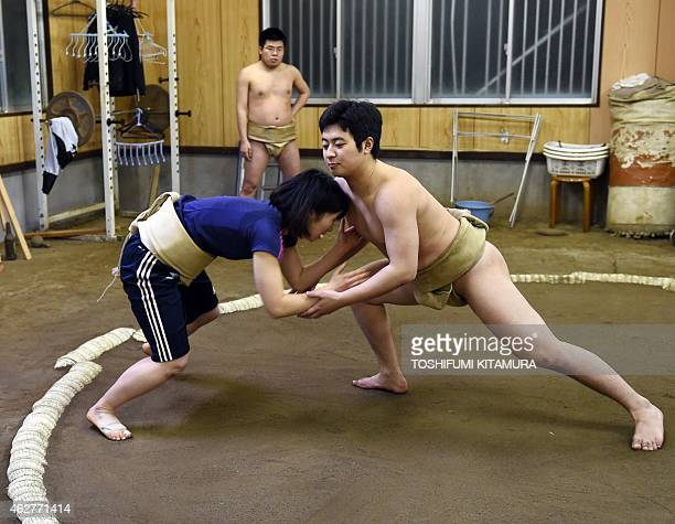To go with AFP story JapanSocialWomenSumo Feature by Jessica Glanz In a photograph taken on January 21 female sumo wrestler Anna Fujita fights with...