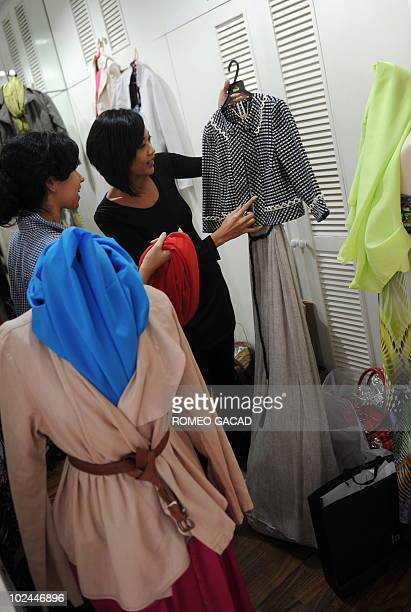 To go with AFP story LifestyleAsiareligionmediasocietySingapore by Philip Lim In this photograph taken on June 10 Singaporean Muslim publisher Liana...