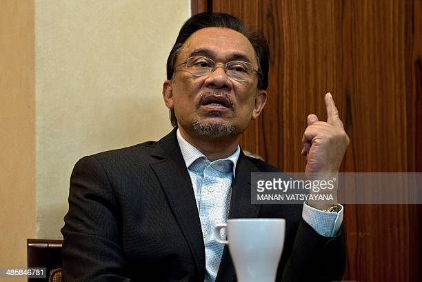 To go with AFP Story MalaysiapoliticsAnwaraviation Focus by Shannon Teoh In this picture taken on April 9 2014 Malaysian opposition leader Anwar...