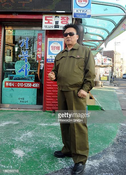 NKoreapoliticsentertainmentoffbeatINTERVIEW by Daneil Rook South Korean Kim YoungShik a lookalike of North Korean Leader Kim JongIl poses in front of...