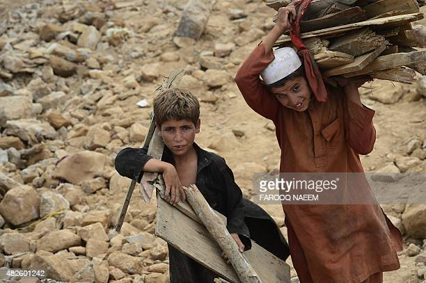 To go with AFP story 'Pakistanhousingurbanplanningsocial' by Issam AHMED In this photograph taken on July 31 Afghan refugees and Pakistani tribal...
